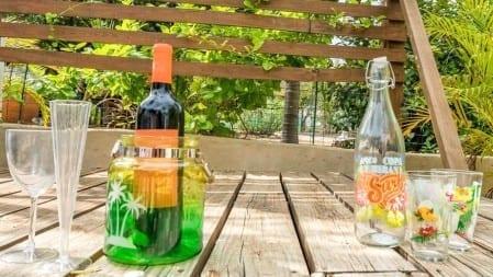 Bij aankomst bij Villa Kolibrie staat er een flesje wijn voor je klaar!